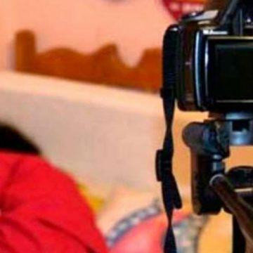 Arestat pentru pornografie infantilă. A șantajat o copilă de 11 ani cu fotografii indecente